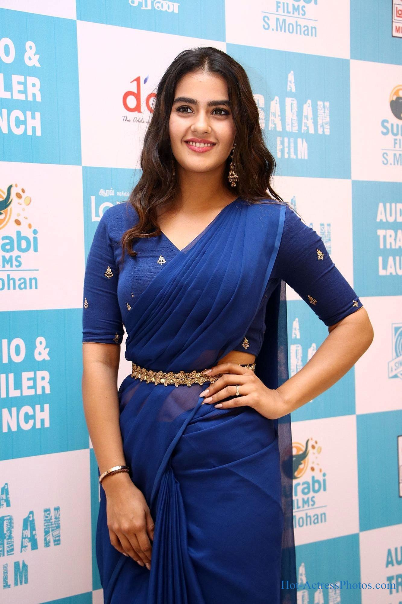 Kavya Thapar Hot Photos In Blue Saree At Market Raja MBBS Movie Audio Launch