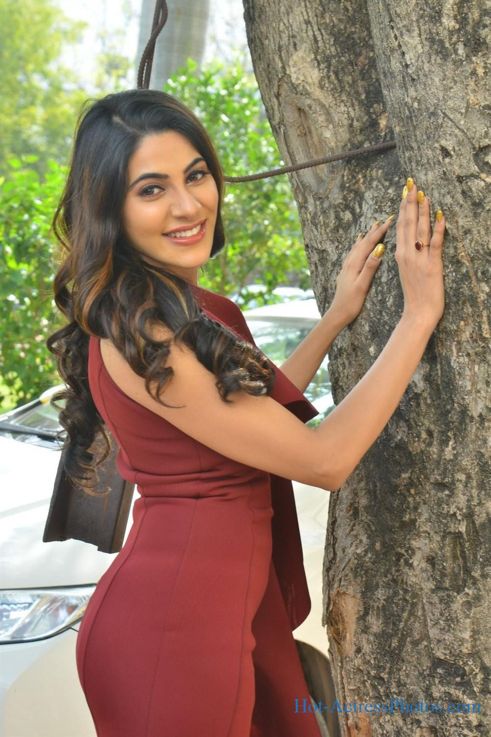 Nikki Tamboli Hot Photos in Red Dress